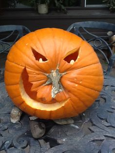 Use the stem of a pumpkin for a cute nose and make pupils in the eyes out of pumpkin seeds