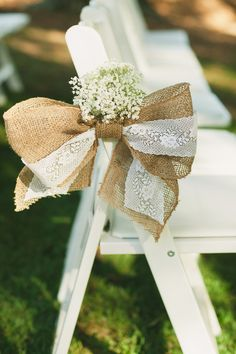 Simple, pretty burlap bow with baby's breath to decorate the end of each row of chairs down the ceremony aisle.