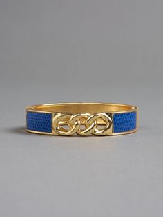 Lizard embossed faux leather bangle bracelet with triple golden links. Magnetic hinged closure. 1/2 inch width