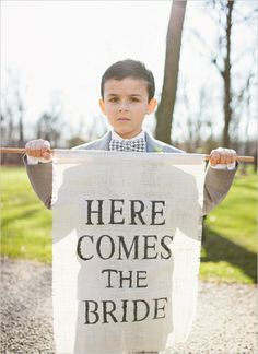 ring bearer + sign... my nephew would be so cute doing this and he would do a good job