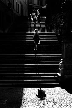 """Long legs"" by Pierre Pichot - #fstoppers #Street #alone #black #black&white #blackandwhite #city #cubblestones #shadow #legs #woman #staires"
