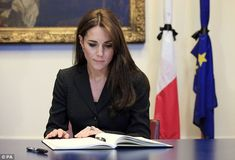 11.17.15 William and Kate visited the French embassy in Knightsbridge, London, to sign a book of condolence for those killed in Friday's atrocities