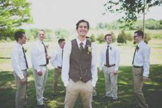 Andy in a vest and khaki's & groomsmen with a white shirt & khaki's with brown suspenders & a bow tie. (flowers mustard yellow)