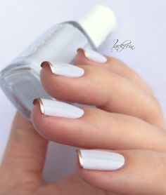white nails with gold tips: