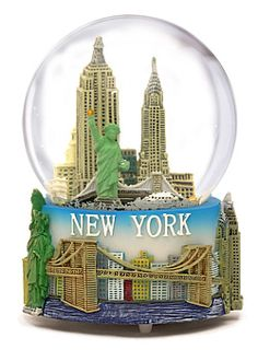 This New York souvenir snow glboe Featuring Lady Liberty, Empire State Building, Chrysler Building, Flatiron Building, Grand central Terminal