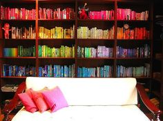 Books sorted on shelves by color