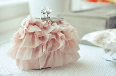 Sweet pink ruffles and a jeweled clasp, like a whole ballet at your fingertips!