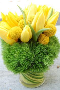 simple arrangement of yellow tulips, craspedia, and green trick dianthus