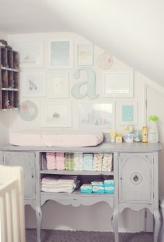 I wish i had thought of this when I had use for a changing table! gorgeous color set! gray, white, pastel, vintage
