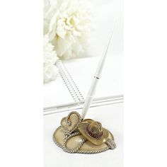 Country Flair Pen Set.  Rustic pen set with resin cowboy hat and rope design. Silver-accented white pen writes in black ink.