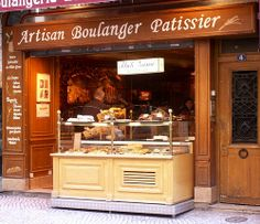 A Boulangerie Pattisserie -this one is at Rue Montorgueil... A Cafe... Sitting under those big umbrellas, the metal chairs, the busy street... with a cup of coffee and a buttery croissant, yum!