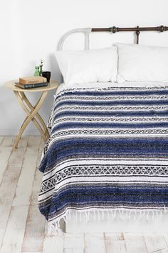 I love the simplicity of this room! I like the Mexican falsa blanket or I could do this with our blanket from Ecuador!