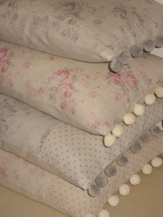 Cushions in Peony & Sage Millie and Dots fabrics, made by Oak House Design and trimmed with our lovely cottom pom poms in pale grey and ivory