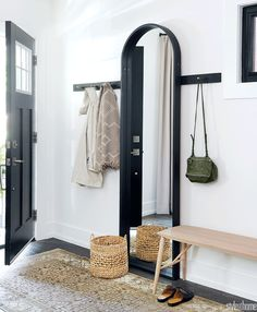 This entryway boasts a simple and striking mix of functional furnishings. To brighten things up and keep the dark floors from feeling… Full Length Mirror Entryway, Entryway Mirror, Foyer, Entryway Ideas, Style At Home, Console Table, Urban Interior Design, Homemade Home Decor, Entry Way Design