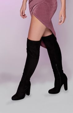 Somebody call the fire brigade - the Billini Lara Boots Black Suede's hotness is off the scale! Made from a smooth, black man-made suede, these ultra long knee-high boots feature a zip fastening on the inner leg, a rounded toe and an 11cm chunky block heel. It should be a crime to look that dayumm hot, girl! Slay it in the Billini Lara Boots Black Suede, rocked with a black slip dress, a red lip and statements jewels - the killer queen ensemble that's almost too hot to handle…