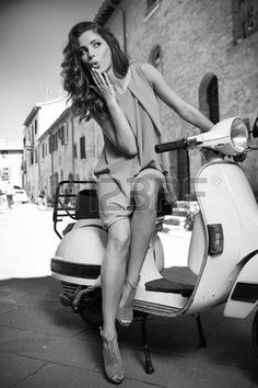 29390743-italian-woman-on-a-scooter-on-the-streets-of-the-tuscan-town-bw-shoot.jpg (300×450)