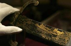 An inscribed hunting sword blade depicting the capture of the French port of Boulogne in 1544, belonging to England's King Henry VIII, is seen at an exhibition at Windsor Castle