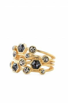 Gem Stackable Ring  Four bands of geometric black diamond Czech and glass stones unite on a shiny 12k gold plated brass band.       •Adjustable shank.     •Fits sizes 5-9.     •Lead & nickel safe.