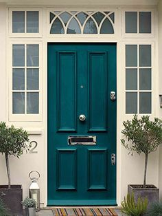 inspiration > B&W color scheme on the house, then a color accent door. This one is a Teal by Dulux