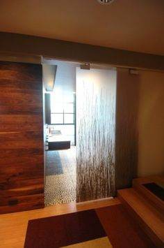 Barn style sliding door into bathroom. Maybe I can add this, to avoid plumbing/electrical inside wall for a pocket door.