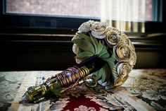 Flower bouquet made of pages from Sherlock Holmes and a Sonic Screwdriver. <>