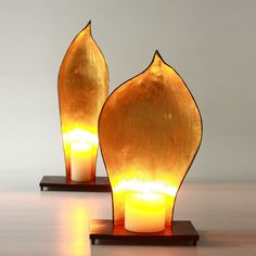 palm seed pod candle holders with gold leaf interior