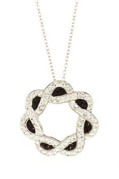 "Candela ""Sterling Silver Black & White Crystal Circle Pendant Necklace""."