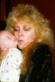 Stevie cuddling somebody's baby   ☆♥❤♥☆       it's such a shame she never had babies of her own