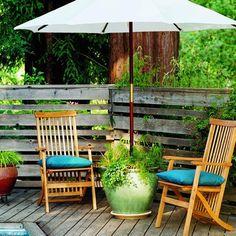 A planter as an umbrella base! via Inspire Bohemia