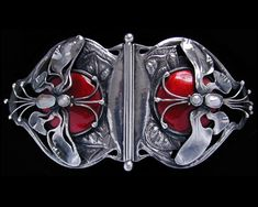 This is not contemporary - image from a gallery of vintage and/or antique objects.C. R. ASHBEE (1863-1942) THE GUILD OF HANDICRAFT Ltd. (1888-1907)  An important silver and enamel buckle set mother-of -pearl formed as two  winged dragonflies.