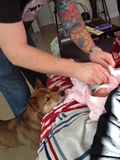 …NOT EVEN DURING DIAPER CHANGING TIME. | 27 Insanely Adorable Baby And Dog Friendships From 2014