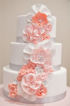 white wedding cake with sugar coral flowers