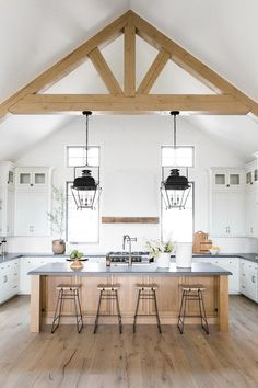 Refined, rustic kitchen with exposed wooden beams, hanging lanterns, painted white brick, oven range in mountain home - Studio McGee Design Rustic Kitchen Design, Farmhouse Style Kitchen, Modern Farmhouse Kitchens, Home Decor Kitchen, Interior Design Kitchen, Kitchen Ideas, Country Kitchens, Farmhouse Decor, Tuscan Kitchens