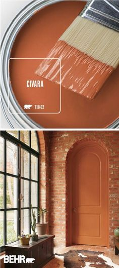 Snuggle up to the warm and cozy style of Civara by BEHR® Paint. This bright red-orange color comes together with exposed brick walls, plenty of natural light, dark wood furniture, and a cowhide rug to create this open and welcoming space. Orange Paint Colors, Warm Paint Colors, Behr Paint Colors, Paint Colors For Home, Wall Colors, Burnt Orange Paint, Warm Bedroom Colors, Orange Painting, Bedroom Red