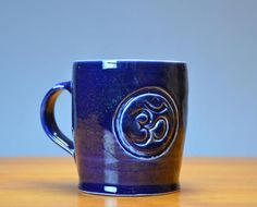 Blue Om Symbol Ceramic Coffee Mug, Hand Thrown Porcelain Pottery, Hand Carved, Coffee Cup, Teacup, Beer Stein, Gift | Caldwell Pottery