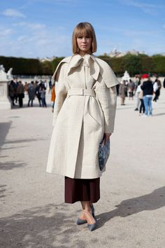 STREET STYLE SPRING 2013: PARIS FASHION WEEK - A ladylike look at coat dressing.