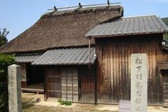traditional charred wood stain deep roof overhang (though prefer shingle roof)