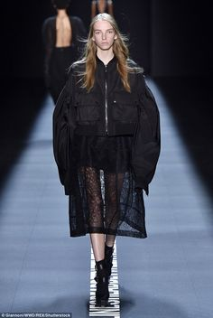 The designer also mixed up fabrics, contrasting heavier ones with light, sheer…