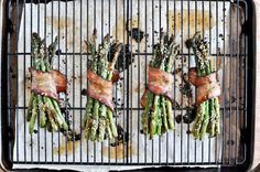 blowkissesnotboys:    Bacon wrapped caramelized sesame asparagus.