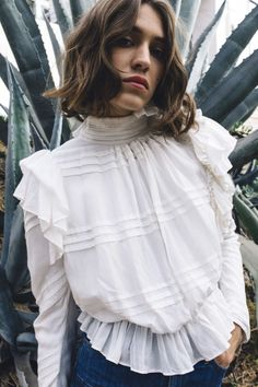 Victorian-inspired ruffles dress up any casual jeans outfit