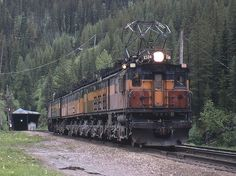 EastPortalMT 6-16-73 by bill hooper  Via Flickr:  Milwaukee Road light helpers on their way from Avery Idaho to Haugan Mont. to assist a westbound freight over the Bitterroots,clear the Bitterroot summit tunnel at East Portal Mt.