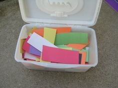 Make a wipes box into a container for paper strips: good fine motor activity and a great way to prepare for an easy craft project.