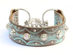 This is a handcrafted turquoise leather martingale dog collar. The leather is sturdy and supple for years of wear. This is a perfect collar for walking your dog safely and in style! The width of the leather is 1.5 and comes in sizes 13-23 Custom orders are available but there are variations in the finishes. A martingale leather collar has a short section of silver metal cinch chain. This design is ideal for dog walking, and training. Its designed to cinch when the leash is pulled so your…