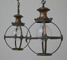A set of 3 small copper globe lanterns (www.matthewcox.com)