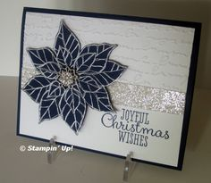Stampin' Up! ... handmade Christmas card ... black, white and silver ... elegant card ... luv the unexpected black poinsettia with silver embossing ... line of silver glitter paper ... mixed fond greeting ... wonderful!