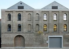 Archipl-Architects converts former washing machine factory into a light-filled workplace.: