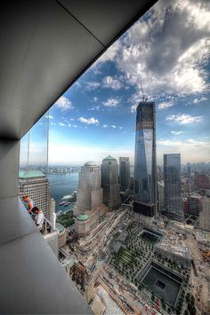 via Twitter (@WTCProgress): A photo of One World Trade Center and the National September 11 Memorial. #911memorial #wtc