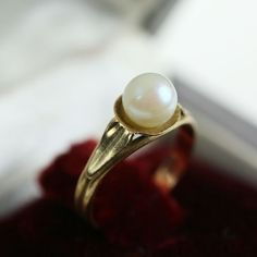 Macro photography, which makes the jewelry bigger than in reality, read the dimensions carefully, thank you.  A beautiful ring of the 30s ! It is made of 750/1000 gold set with a lovely AKOYA Pearl (Japanese cultured sea pearl).  Total weight : approx. 2.01 g Perle : approx Ø 6.12 mm Diameter : Ø 15 mm inside the ring French Size : 48 US Size : 4.5  It is in very good condition, no defect, just a slight wear of time.  This ring has an elegant and discreet style !  On the ring there is th...