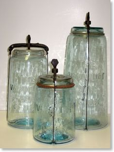 Wonderful antique canning jars with metal clamps to firmly seal the glass caps.