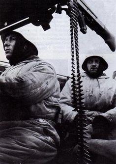 German grenadiers inside a halftrack during the Battle of the Bulge, December 1944.